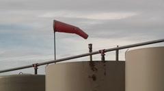 Wind Sock on Oil Tank Stock Footage
