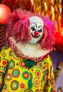 Scary clown robot face. - stock photo