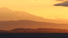 Wide shot of a Layered Costa Rica Sunrise with mountains Stock Footage