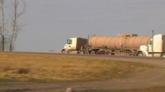2 Crude Oil Transport Trucks on Highway Stock Footage