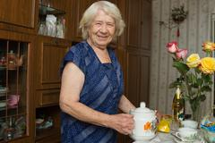 senior woman portrait of a 89 year old lady - stock photo