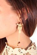 Woman ear with earring Stock Photos