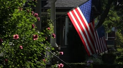 American Flags outside houses in a small town, morning sun Stock Footage