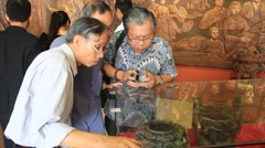 People in antiques market, Asia - stock footage
