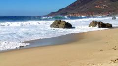 Pristine beach with rocks and waves Stock Footage