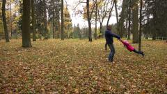Father of the child turns to yellow foliage in the park Stock Footage