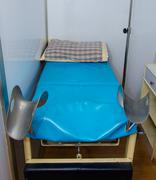 bed for gynecologist cabinet - stock photo