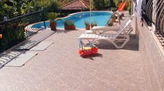 Villa, pool, sun loungers recreation area - stock footage