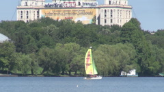 Small dimension sailing boat floating on lake, extreme sports outdoors, playful Stock Footage