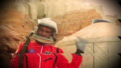 Astronaut waving wave at camera Stock Footage