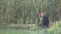Stock Video Footage of Wild lake for old fisherman, cane rod throw in water, survival fishing, poor man