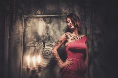 Tattooed beautiful woman in old spooky interior Stock Photos