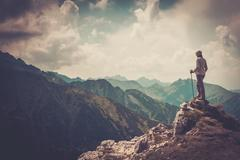 Woman hiker on a top of a mountain Stock Photos