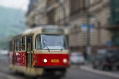 old red tram, intentional blurred background - stock photo