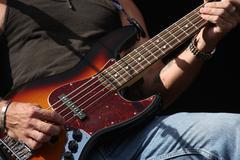 Guitarist playing his guitar Stock Photos