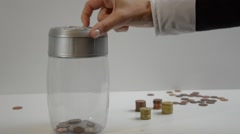 Coins falling in to money box, little savings, concept Stock Footage