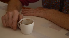 Old hands and coffe cup Stock Footage