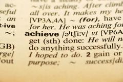 achieve word in dictionary - stock photo