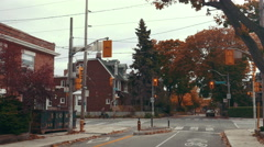 Establishing shot of a busy residential  road / intersection Stock Footage