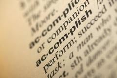 accomplish meaning in dictionary - stock photo