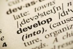Stock Photo of develop meaning in dictionary