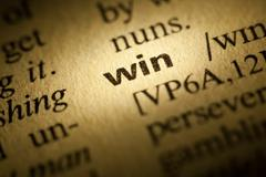 win meaning in dictionary - stock photo