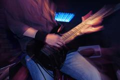 guitarist on a rock concert stage - stock photo