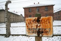 german ww2 prison camp with high voltage sign - stock photo