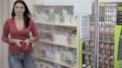 Paying in a pharmacy - stock footage