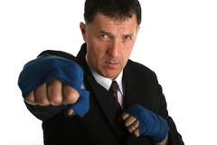 bussinessman geting ready for a fight - stock photo