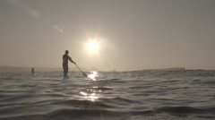 Stand up paddle in super slow motion Stock Footage