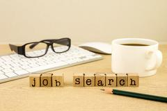 Looking for employment with job search Stock Photos