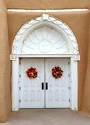 door to the san francisco de asis church in taos, mew mexico - stock photo