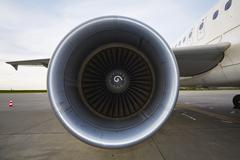 engine of the airplane at the airport - stock photo