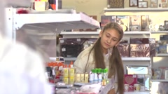 cute schoolgirl in the stationery store shopping - stock footage