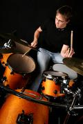 young drummer man play drum  - stock photo