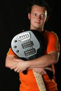 young good looking rock guitarist - stock photo