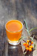 sea buckthorn juice and berries - stock photo