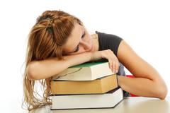 pretty student fell asleep while studying - stock photo