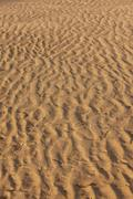 Beach sand texture wave pattern - stock photo