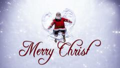 Santa Claus makes a Snow Angel with Merry Christrmas text Stock Footage