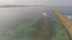 2,7k aerial view of magical coast line (with Stand Up Paddle) 2 Stock Footage