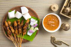 Chicken satay shot from top down Stock Photos