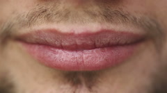 SLOW MOTION: Close up of a beautiful male lips. Man showing braces on teeth Stock Footage