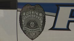 Police-13, Tallahassee, CU Tallahassee PD badge logo on car door Stock Footage