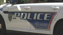 Police-10, Tallahassee, CU Tallahassee PD car left door & logos, lettering Stock Footage