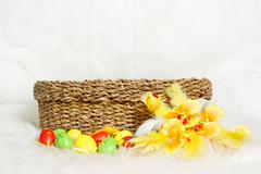 Empty easter basket with multicolor easter eggs and flower. copy space Kuvituskuvat