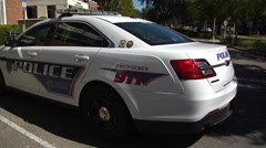 Police-15, Tallahassee, WS TPD cruiser tilt/pan to WS car/building Stock Footage