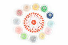 Multicolor sewing bobbin on white background Stock Photos