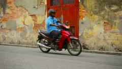 George town, penang, malaysia - 22 jul 2014: boy on a bike - wall painting al Stock Footage